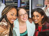 stock photo of bff  - Diverse group of three young women in cafe