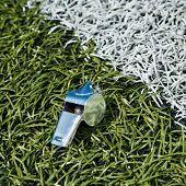 stock photo of offside  - Whistle and soccer ball on a soccer field - JPG