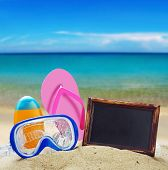 image of blue things  - blackboard and things for the beach against the blue sea - JPG