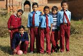 BHAKTAPUR, NEPAL, NOVEMBER 24: Nepalese kids soccer amateur team posing under the sunlight in the ci