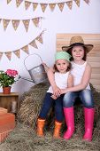 Beautiful small girls on country style background