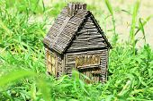 Small wooden house on grass, outdoors