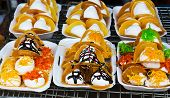 stock photo of crepes  - Thailand dessert style of crispy crepes in market - JPG