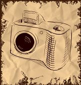 Photo camera isolated on vintage background