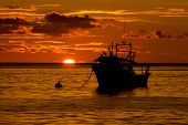 Boat on sea at sunset
