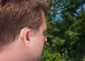 Middle-aged Man's Hearing Aid