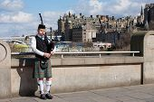 Edinburgh, Uk - April 25, 2013: Scottish Bagpiper Playing Music With Bagpipe At Edinburgh In Scotlan