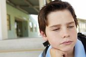 picture of pre-teen boy  - Unhappy Pre teen boy at school - JPG