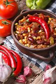 Chili Con Carne In A Pot And Ingredients. Vertical