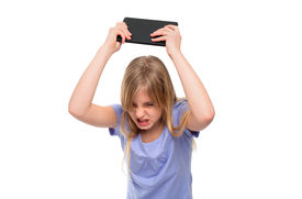 picture of pissed off  - Angry teen girl pissed off with her tablet so she flooring it - JPG