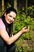 Smiling Farmer Woman In A Spring  Vineyard