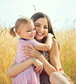 Pretty Young Mother With Daughter Are Happy In Sunny Day