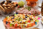 foto of fruit platter  - Canapes of cheese with fruits close - JPG