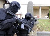 picture of anti-terrorism  - Special force police in action aiming guns