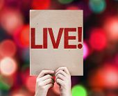 Live! written on colorful background with defocused lights
