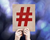 Hashtag Icon written on colorful background with defocused lights