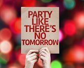 Party Like There's No Tomorrow written on colorful background with defocused lights