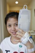 Patient Hold her IV drip tube to go to toilet. Focus on the hand holding the IV tube