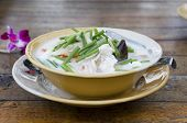 Thai soup tom-kha with coconut milk and seafood
