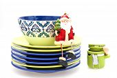 Ceramic kitchen ware of various colors for laying of a New Year's dinner