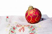 Red Christmas ball embroidered napkin isolated