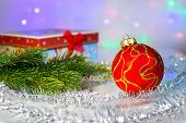 Red Christmas ball, fir branch and with gift box