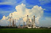 Petrochemical Oil Refinery With Cloud And Blue Sky.