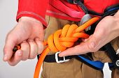 Climber Tying Double Bowline Knot
