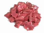 Raw lamb steak meat, diced for making into kebabs.