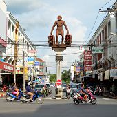 29 November, 2014: Street art, Statue of Neanderthal man, unusual traffic lights in Krabi town, Thailand