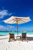 Sun Umbrella With Santa Claus Hat On Chairs