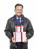 Handsome Man Wearing Black Leather Jacket and Holiday Scarf Holding Christmas Gifts Isolated on White Background.