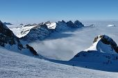 foto of tit  - Skiing above the fog Titlis ski area - JPG