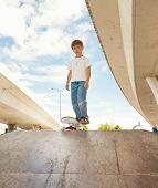 a cute young boy at a local skate park