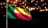 Benin National Flag City Light Night Bokeh Background 3D