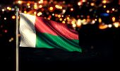 Madagascar National Flag City Light Night Bokeh Background 3D