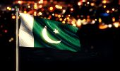 foto of pakistani flag  - Pakistan National Flag City Light Night Broken Background 3D - JPG