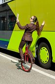 foto of unicycle  - woman through the city with the unicycle to go to work - JPG