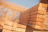 stock photo of lumber  - Stack of Building Lumber at Construction Site with Narrow Depth of Field - JPG
