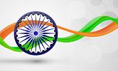 picture of indian independence day  - Indian Independence and Republic Day celebration concept with ashoka wheel and national flag colors waves on abstract shiny grey background - JPG