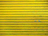 stock photo of roller shutter door  - close up of grunge bright yellow roller shutter door texture background - JPG