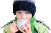 the boy drinks tea