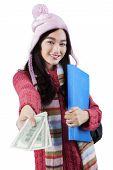 Cute Girl In Winter Wear Offering Money