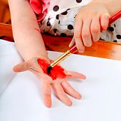 Little Girl Drawing On The Hand
