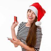 Woman with credit card on Christmas