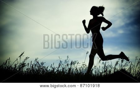 poster of Young woman running summer park rural road. Outdoor exercises. J