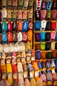 stock photo of shoes colorful  - Colorful handmade leather shoes in Marrakesh Morocco - JPG