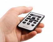 stock photo of controller  - remote controller in hand on white background - JPG