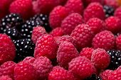 stock photo of blackberries  - Fresh raspberries and blackberries macro closeup image - JPG