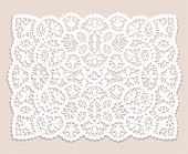 foto of lace  - White lace doily with flowery pattern on a beige background - JPG